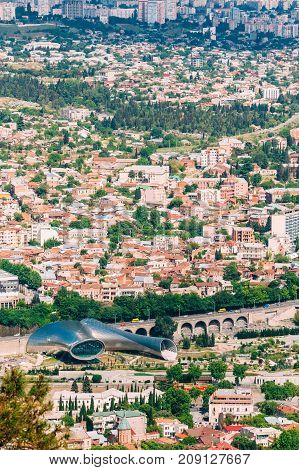 Tbilisi, Georgia - May 20, 2016: Aerial View Of Music Theatre, New Cultural Center With Rike Park And Stone Baratashvili Rise. Residential Districts Background In Sunny Summer.