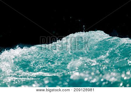 sea wave on a black background . Photo of abstract background