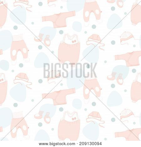 On a white background colored sketches of clothes. Seamless pattern with cute hand drawn baby clothes. Newborn baby  collection.