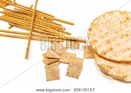 Flat Cakes, Breadcrumbs, Bread Sticks, Chips Isolated