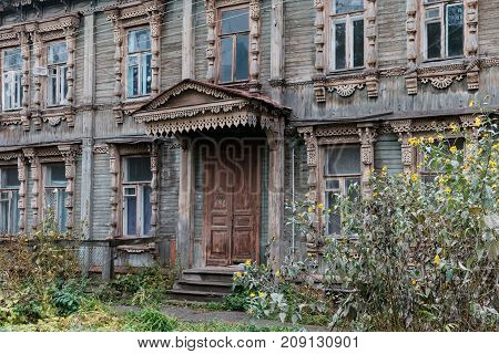 beautiful facade of old wooden houses with carved window casings and porch