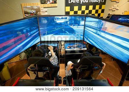 BUSAN, SOUTH KOREA - MAY 28, 2017: people play video game at Lotte Department Store.