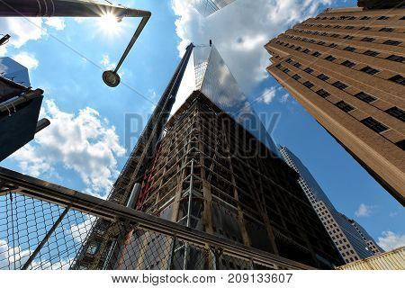 New-York buildings view from street level with Freedom Tower in construction