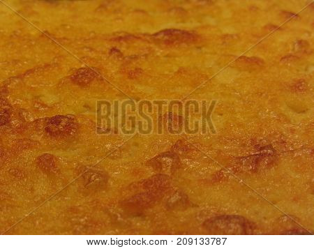 Closeup of chickpea flour pancake known as Cecina in Tuscany (or Farinata in Liguria) Italy . The ingredients are chickpea flour olive oil salt and water