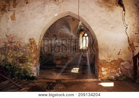 rays of light entering an abandoned damaged gothic church