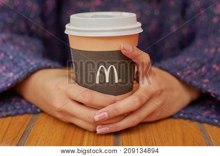 KALININGRAD, RUSSIA - CIRCA SEPTEMBER, 2017: close up shot of McDonald's disposable paper coffee cup.