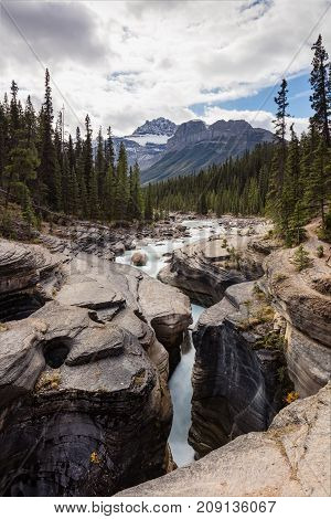 Mistaya Canyon waterfall and stream, Banff National Park, Alberta, Canada
