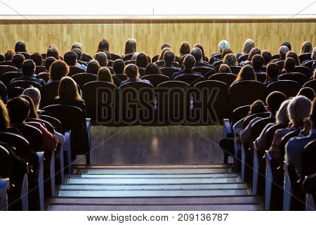 People in the auditorium during the performance. A theatrical production.