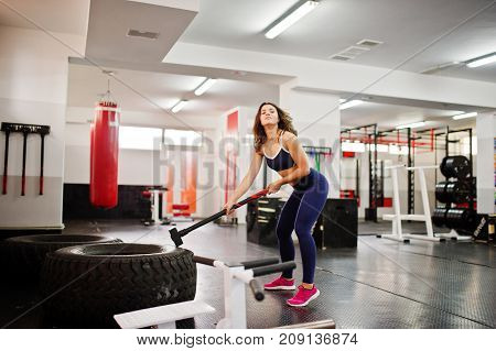 Young Beautiful Woman Doing Exercises  And Working Hard In Gym And Enjoying Her Training Process.
