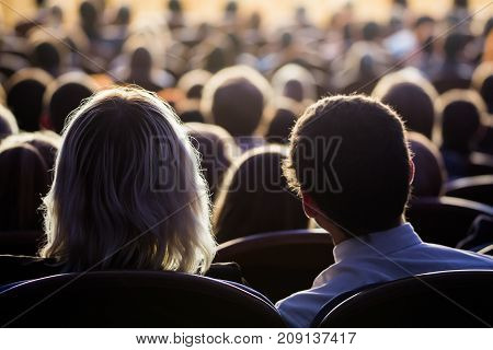 People in the auditorium during the performance. A theatrical production. poster