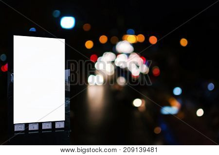 blank advertising billboard or showcase light box with copy space for your text message or media and content with city night light bokeh background commercial marketing and advertising concept