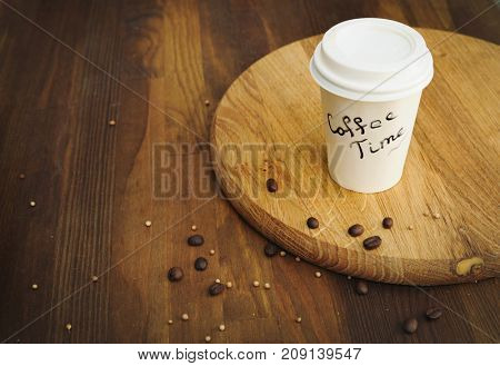Coffee paper cup on vintage wooden background, coffee time