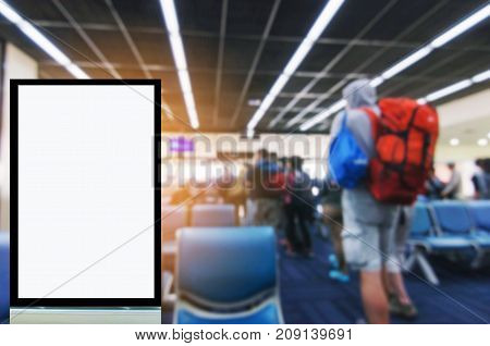 blank advertising billboard or showcase light box with copy space for your text message or media and content with traveler waiting at airport people commercial marketing and advertising concept
