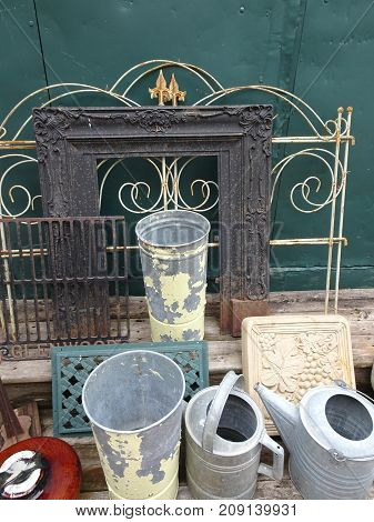 An array of salvaged antique cans and ornate frames prompt ideas for repurposing.