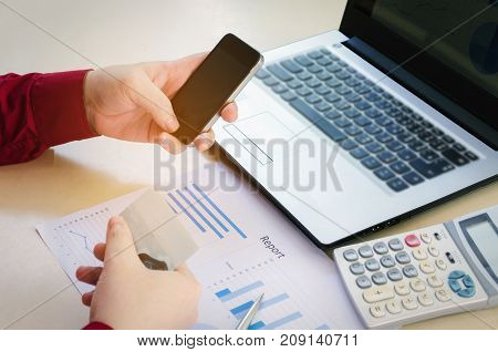 young man entering security code with mobile phone and paying with credit card for online shopping and payment financial saving and technology concept.