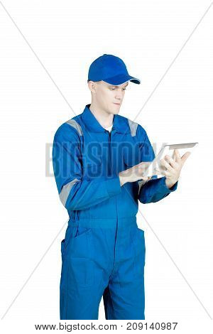 Portrait of European male mechanic working with a digital tablet isolated on white background
