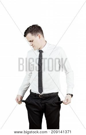 European businessman standing in the studio while showing his empty pocket of pants isolated on white background