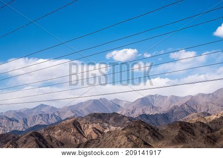 Electric cables with blue sky background in Ladakh city India