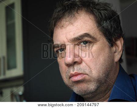 Close-up portrait of a mature sullen sad man