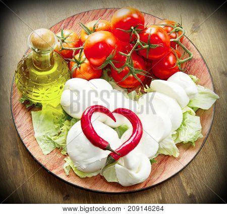 a fresh italian mozzarella with tomato with salad