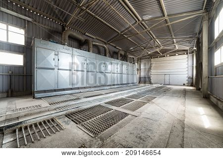 A large hangar with a floor made of steel gratings. A building for unloading wheat.