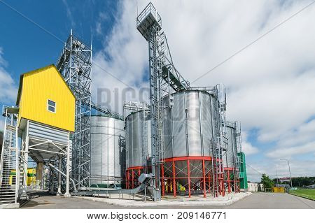 Modern large granary. Sunny day, blue sky, white clouds