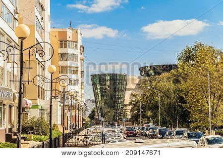 Belgorod Russia - September 29 2017: Narodniy (People's) Boulevard. Roadway residential buildings and the Belgorod State Philharmonic.