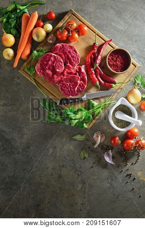 Goulash or beef stew ingredients ready to be cooked on a kitchen stone table surface view from above space for a text flat lay composition