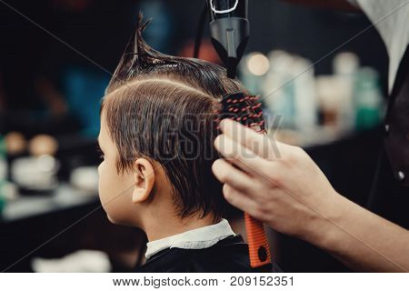 Barber shop. Barbershop little boy getting his head shaved by barber