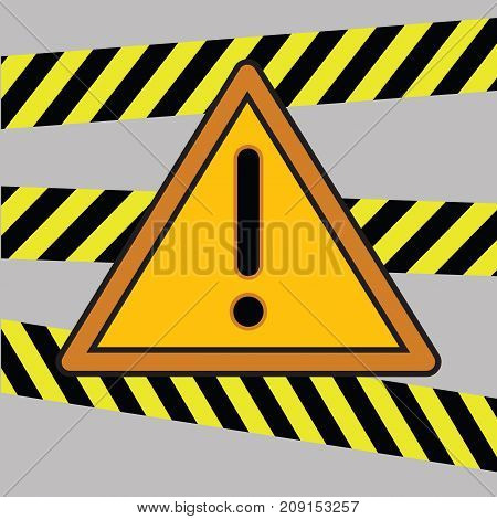 danger warning triangle sign and tape on grey backgound