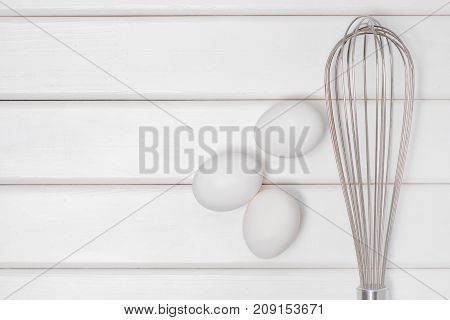 White eggs corolla on a white wooden background
