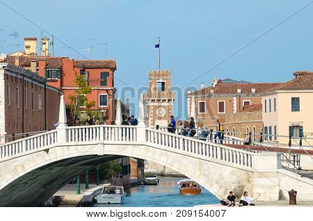 VENICE ITALY - SEPTEMBER 29 2017: Motorboats and bridge over a canal in the city of Venice Italy