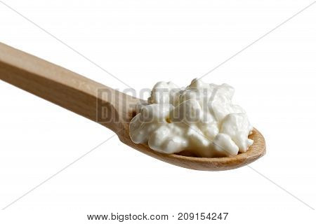 Chunky Cottage Cheese On Wooden Spoon Isolated On White.
