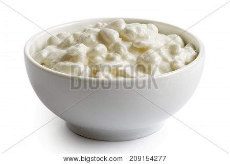 White Ceramic Bowl Of Chunky Cottage Cheese Isolated On White.