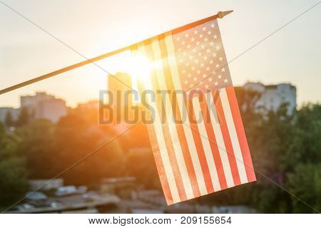 American Flag From The Window Sunset Background
