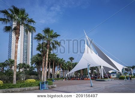 modern riverside promenade pedestrian park area in central xiamen city china