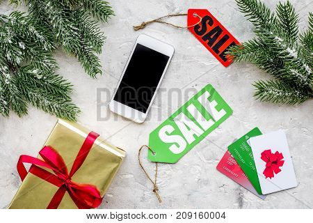 order new year 2018 present with sale with credit card and mobile on gray stone table background top view mock up