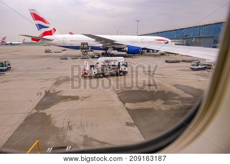 Heathrow Terminal 5 London UK- September 25 2017: View from the plane window of British Airways plane being prepared for next journey. Horizontal daytime shot.