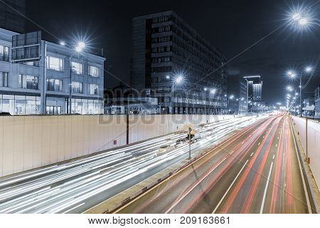 View of transport metropolis, traffic and blurry lights of cars on multi-lane highways and road junction at night in Moscow