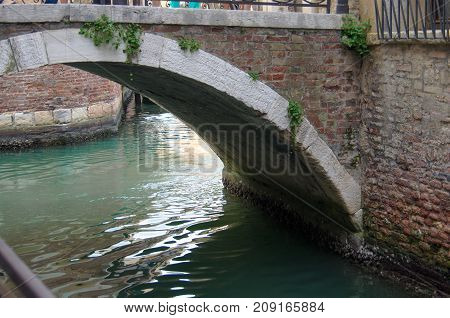 Bridge over the canal of Venice Italy.