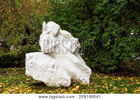 old dirty statue of an angel in an autumn forest