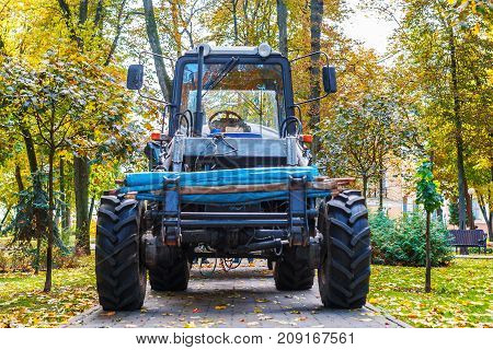 a tractor standing in front of the nature. Tractor Belarus in the forest