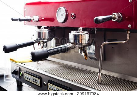 Closeup of coffee machine at restaurant or cafe. Small business and professional coffee brewing concept