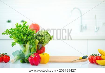 Beauty kitchen table with fresh organic vegetables and fruits at home. Healthy eating concept. Diet, dieting, slimming, weight loss. Cooking at home. Healthy Lifestyle. Nobody.