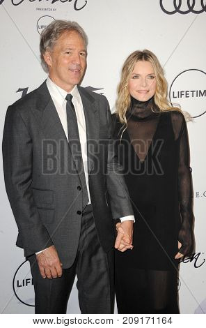 David E. Kelley and Michelle Pfeiffer at the Variety's Power Of Women: Los Angeles held at the Beverly Wilshire Four Seasons Hotel in Beverly Hills, USA on October 13, 2017.