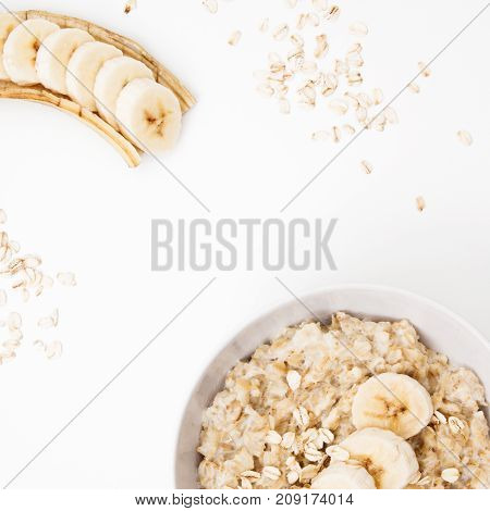 Minimal Style. Minimalist Photography. Bowl Of Oatmeal Porridge With Banana And Caramel Sauce, Hot A