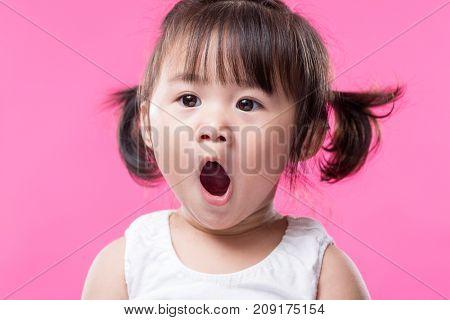 Baby girl yawn
