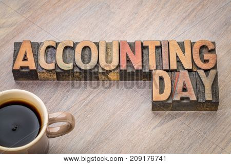 Accounting Day - word abstract in vintage letterpress wood  type with a cup of coffee