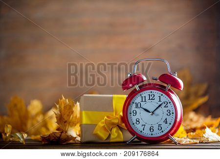 Vintage Alarm Clock And Maple Tree Leaves With Gift Box