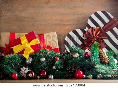 Gift Box With Pine Cones And Branches